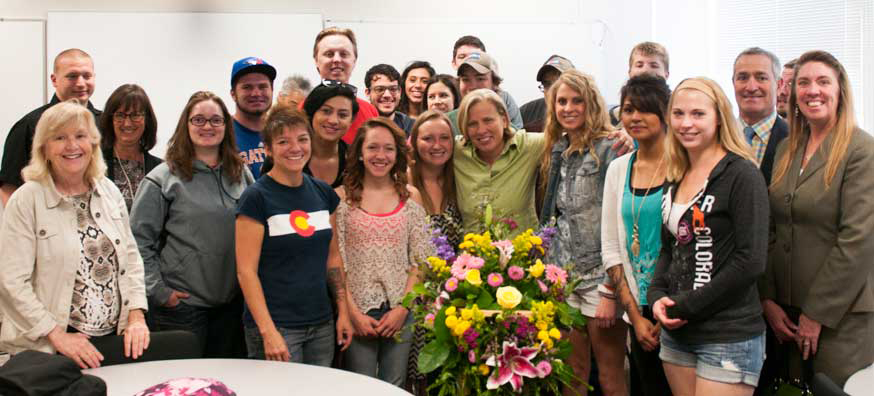 RRCC's 2015-2017 Endowed Teaching Chair Merri Mattison, Ph.D. (center, in green) is surrounded by college leadership and her students after receiving the honor on April 30.