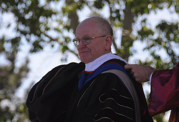 Dr. John Trefny, president emeritus of Colorado School of Mines and long-time supporter of community colleges, received an honorary degree from Red Rocks.