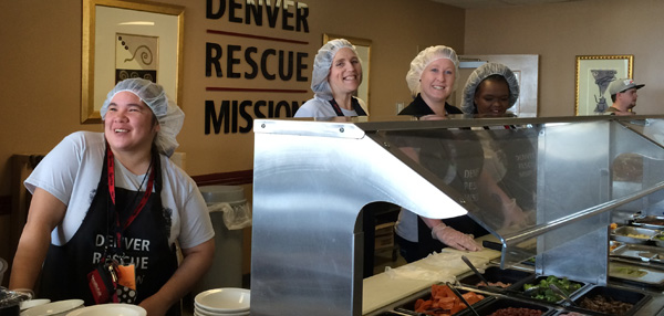 Photo of students volunteering at Denver Rescue Mission serving food to the homeless
