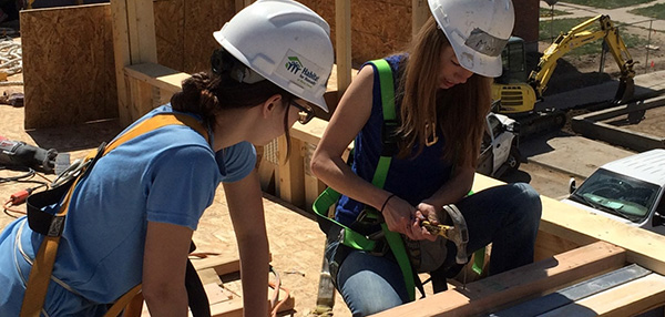 Image of volunteers doing construction work for Habitat for Humanity