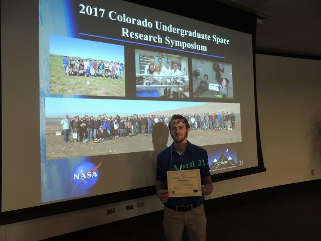 Christain Prather, Grand Prize winner at the research symposium for best talk and paper.