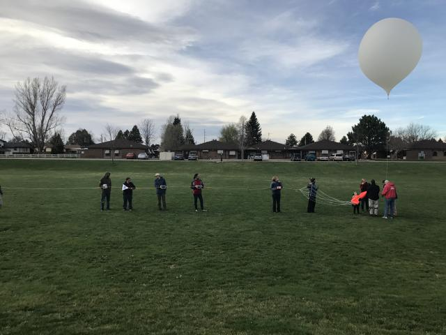 High altitude balloon launch photo of the balloon and payloads before release